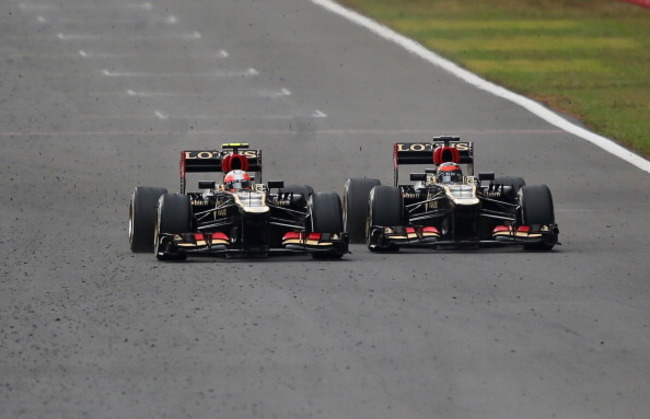 183227313-kimi-raikkonen-of-finland-and-lotus-overtakes-romain_crop_650