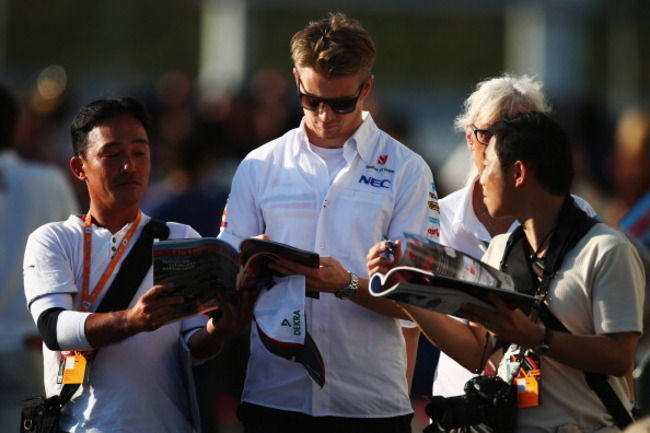 183910831-nico-hulkenberg-of-germany-and-sauber-f1-signs_crop_650