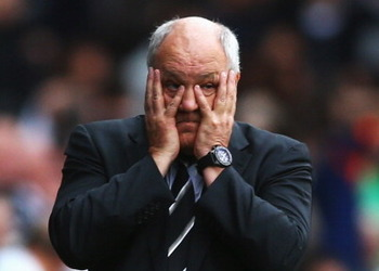 183156394-fulham-manager-martin-jol-looks-on-during-the-barclays_display_image