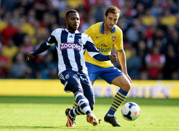 183436108-stephane-sessegnon-of-west-bromwich-albion-holds-off_display_image