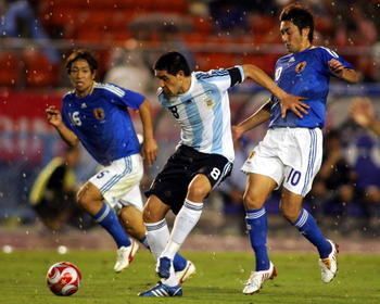 82100645-yohei-kajiyama-of-japan-and-juan-roman-riquelme-of_display_image