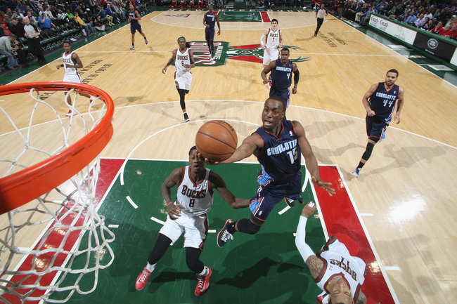 Hi-res-165211387-kemba-walker-of-the-charlotte-bobcats-shoots-against_crop_650