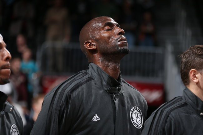 Hi-res-184239675-kevin-garnett-of-the-brooklyn-nets-stands-for-the_crop_650