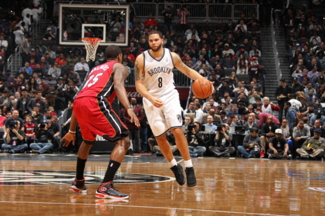 160397066-deron-williams-of-the-brooklyn-nets-dribbles-against_crop_650