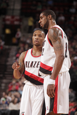 Hi-res-173319416-damian-lillard-of-the-portland-trail-blazers-shares-a_display_image