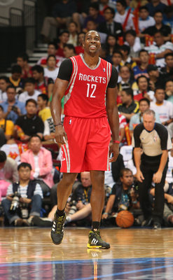 Hi-res-183935926-dwight-howard-of-the-houston-rockets-looks-on-against_display_image
