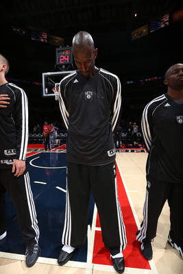 Hi-res-183662511-kevin-garnett-of-the-brooklyn-nets-stands-during-the_display_image