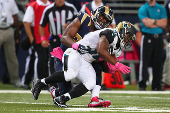 Hi-res-183457130-robert-quinn-of-the-st-louis-rams-tackles-maurice-jones_display_image