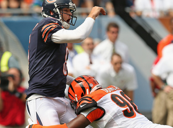 Hi-res-180222493-carlos-dunlap-of-the-cincinnati-bengals-hits-jay-cutler_display_image