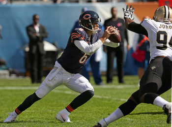 Hi-res-183457097-jay-cutler-of-the-chicago-bears-tries-to-avoid-the-rush_display_image