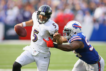 Hi-res-182351335-joe-flacco-of-the-baltimore-ravens-tries-to-run-away_display_image