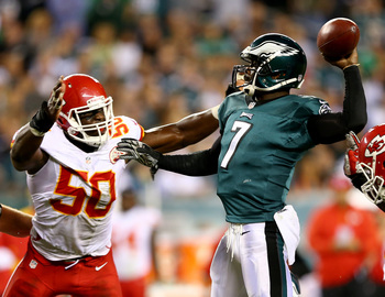 Hi-res-181210987-michael-vick-of-the-philadelphia-eagles-is-pressured-by_display_image