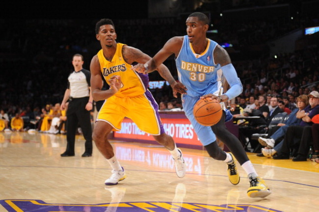 183488241-quincy-miller-of-the-denver-nuggets-drives-to-the_crop_650