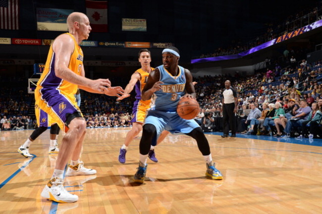 183674261-ty-lawson-of-the-denver-nuggets-drives-to-the-basket_crop_650