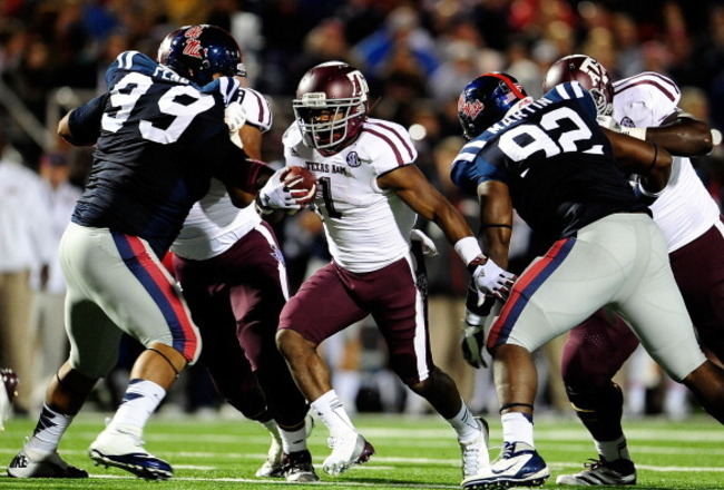 153594582-ben-malena-of-the-texas-a-m-aggies-runs-for-yards_crop_650x440