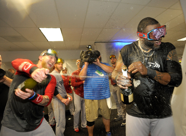 Hi-res-183676685-mike-carp-and-david-ortiz-of-the-boston-red-sox_crop_650
