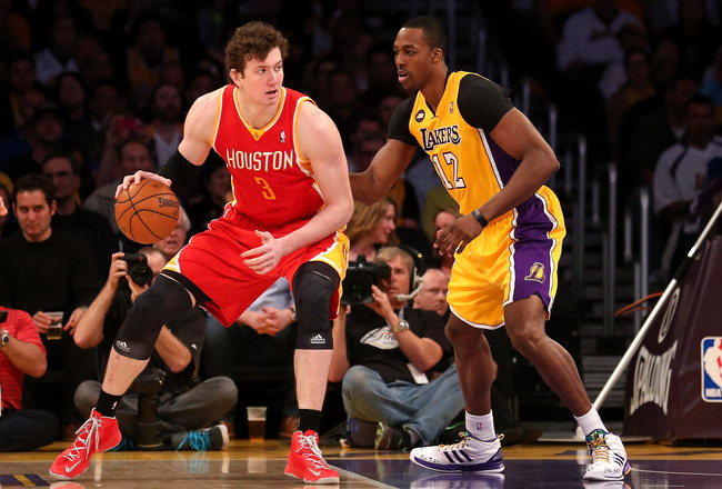 Hi-res-166847913-omer-asik-of-the-houston-rockets-controls-the-ball_crop_650x440