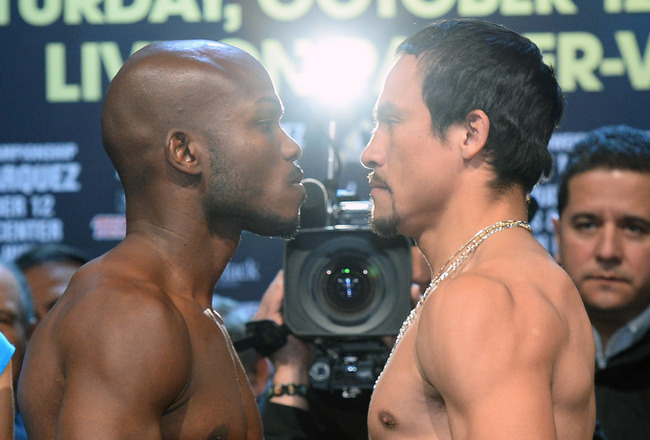 Hi-res-184149488-welterweight-champion-timothy-bradley-jr-and-juan_crop_650x440