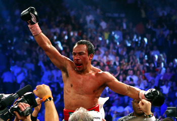 Hi-res-158016492-juan-manuel-marquez-celebrates-after-defeating-manny_display_image