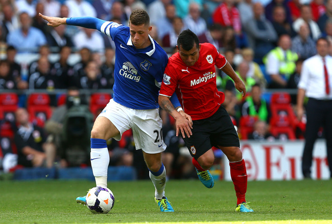 Hi-res-178925689-ross-barkley-of-everton-controls-the-ball-from-gary_crop_650x440