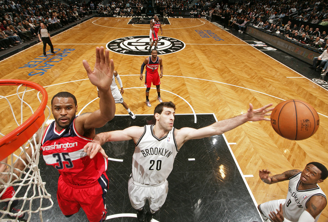 Hi-res-169140683-tornike-shengelia-of-the-brooklyn-nets-grabs-a-rebound_crop_650x440