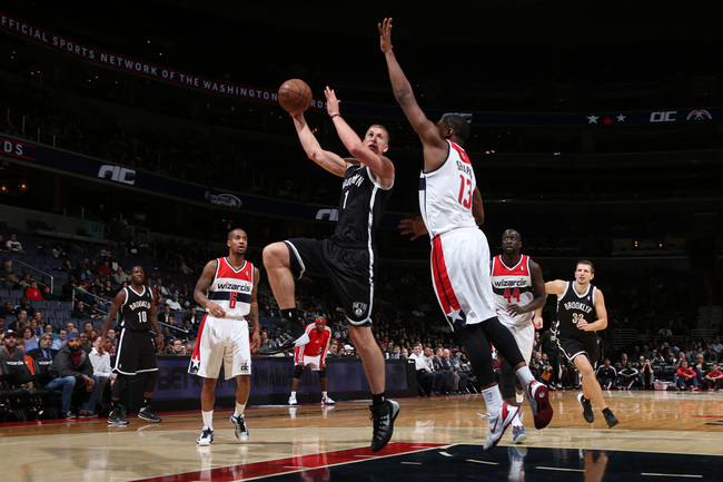 Hi-res-183666637-mason-plumlee-of-the-brooklyn-nets-shoots-against-kevin_crop_650