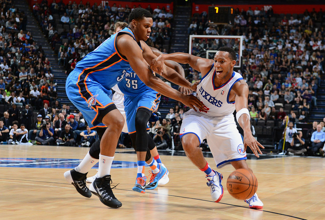 Hi-res-183659340-evan-turner-of-the-philadelphia-76ers-drives-to-the_crop_650x440