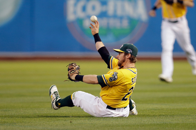 Hi-res-183192319-eric-sogard-of-the-oakland-athletics-fields-the-ball-in_crop_650