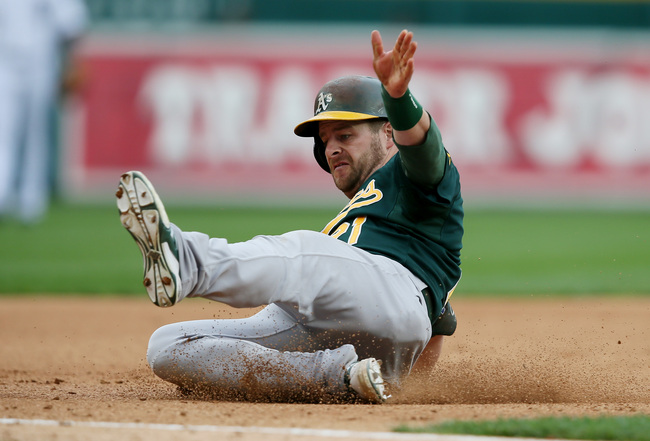 Hi-res-183573658-stephen-vogt-of-the-oakland-athletics-slides-into-third_crop_650