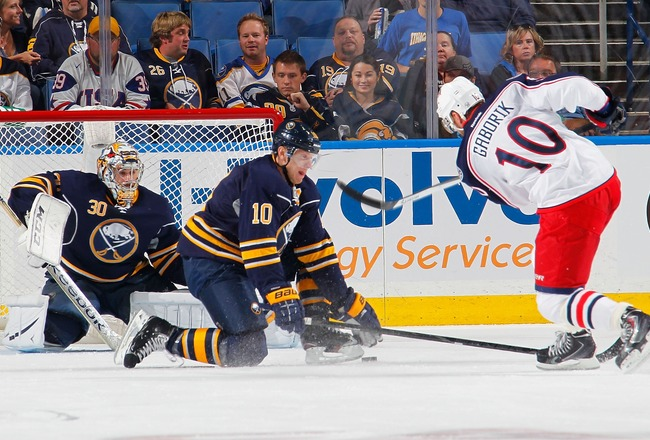 Hi-res-183985250-christian-ehrhoff-and-ryan-miller-of-the-buffalo-sabres_crop_650x440