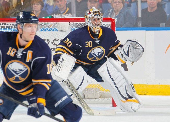 Hi-res-183657113-christian-ehrhoff-and-ryan-miller-of-the-buffalo-sabres_crop_650