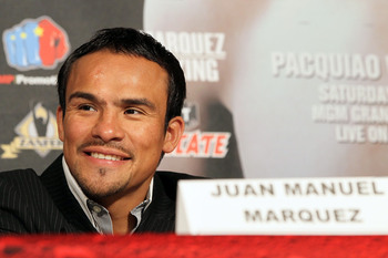 Hi-res-152229049-boxer-juan-manuel-marquez-smiles-during-the-manny_display_image