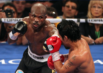 Hi-res-146226082-timothy-bradley-lands-a-left-to-the-head-of-manny_display_image