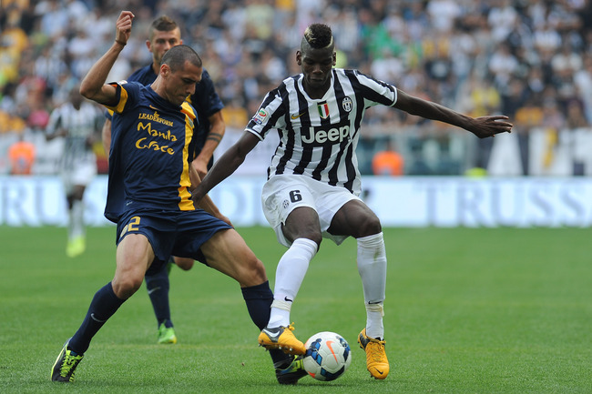 Hi-res-181997263-paul-pogba-of-juventus-is-tackled-by-romulo-souza-of_crop_650