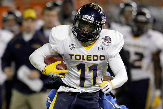 Hi-res-136213140-bernard-reedy-of-the-toledo-rockets-rushes-for-a_crop_650