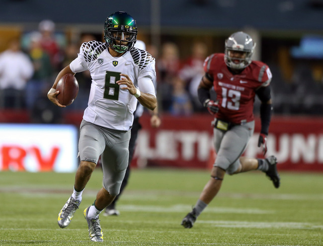 Hi-res-153206796-quarterback-marcus-mariota-of-the-oregon-ducks-rushes_crop_650
