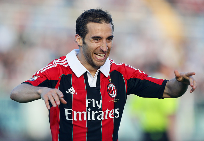 Hi-res-168303170-mathieu-flamini-of-ac-milan-celebrates-after-scoring_crop_650