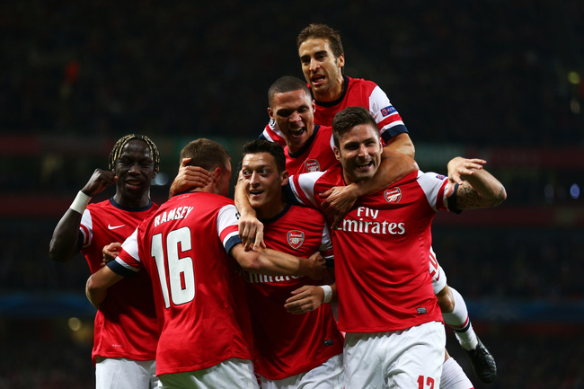Hi-res-182601297-mesut-oezil-of-arsenal-is-congratulated-by-teammates_crop_650