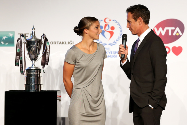ISTANBUL, TURKEY - OCTOBER 20: Sara Errani of Italy is interviewed by Master of Ceremonies Andrew Krasny during the draw ceremony for the WTA Championships at the Renaissance Polat Hotel on October 20, 2013 in Istanbul, Turkey.  (Photo by Matthew Stockman
