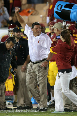Hi-res-184014276-interim-head-coach-ed-orgeron-of-the-usc-trojans-raises_display_image