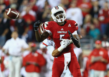 Hi-res-184006035-teddy-bridgewater-of-the-louisville-cardinals-fumbles_display_image