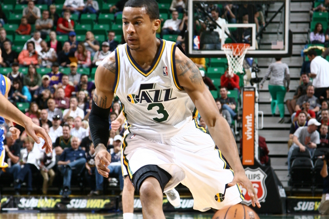 Hi-res-183669708-trey-burke-of-the-utah-jazz-drives-to-the-basket_crop_650