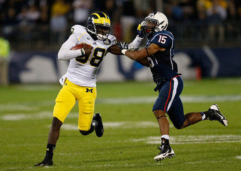 Hi-res-181507466-devin-gardner-of-the-michigan-wolverines-runs-by-ty_display_image