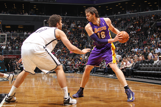 Hi-res-160785159-pau-gasol-of-the-los-angeles-lakers-controls-the-ball_crop_650