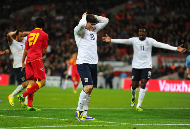 Hi-res-184071638-wayne-rooney-of-england-reacts-after-missing-a-chance_crop_650