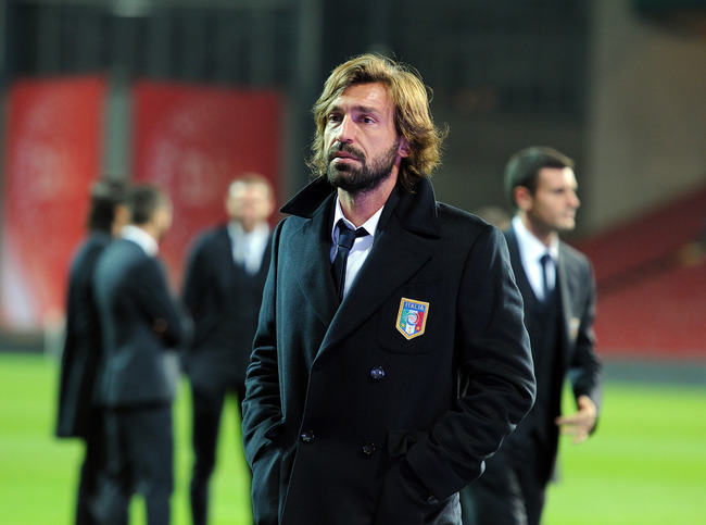 Hi-res-183959891-andrea-pirlo-of-italy-inspects-the-pitch-ahead-of_crop_650