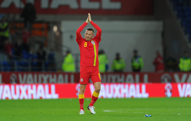 Hi-res-184076096-wales-player-craig-bellamy-applauds-the-crowd-after-his_crop_650
