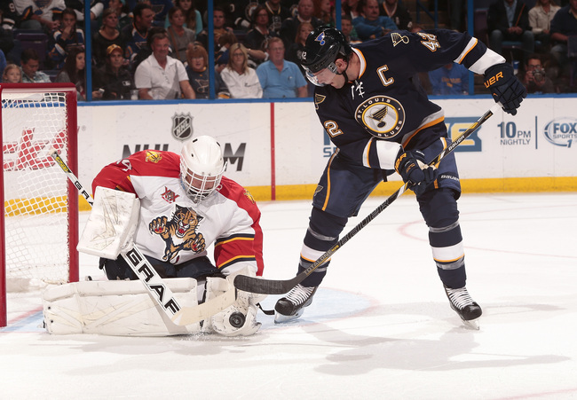Hi-res-183192678-tim-thomas-of-the-florida-panthers-makes-a-save-against_crop_650