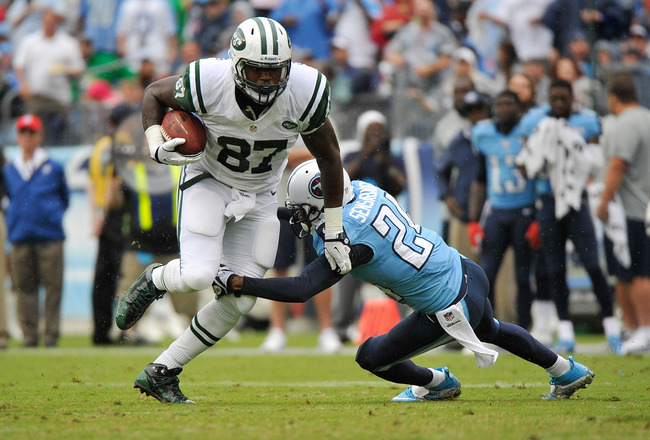 Hi-res-182351539-jeff-cumberland-of-the-new-york-jets-is-tackled-by-coty_crop_650x440
