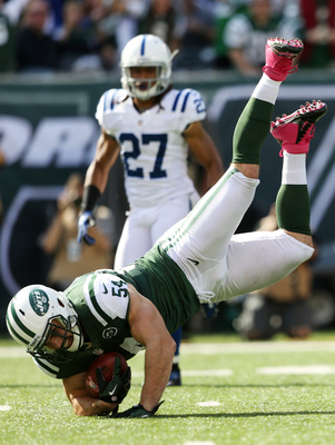 Hi-res-154117380-nick-bellore-of-the-new-york-jets-is-tackled-by-t-y_display_image